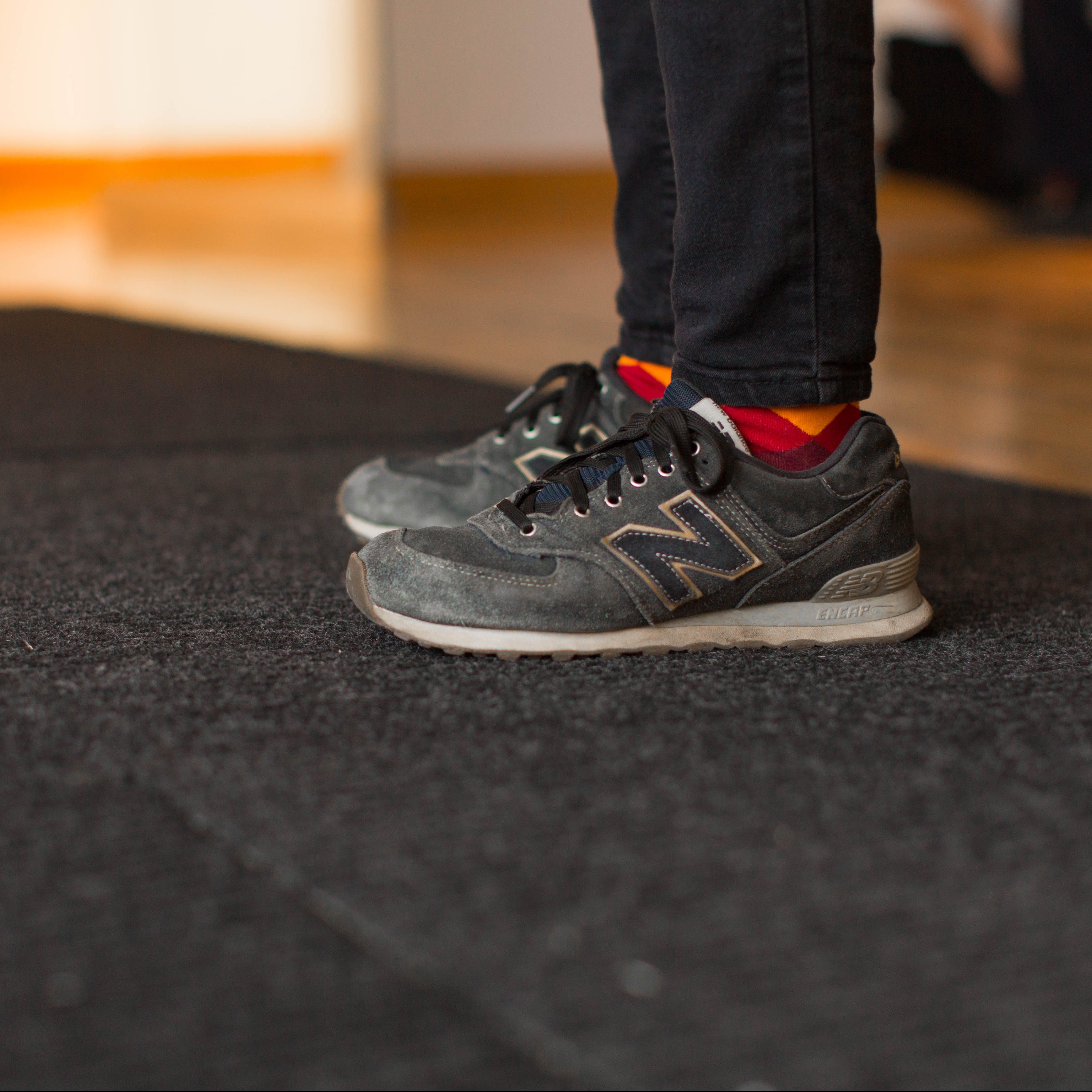 Gallery visitor feet on floor