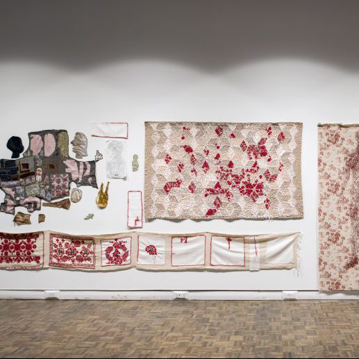 Textile art hanging on gallery wall